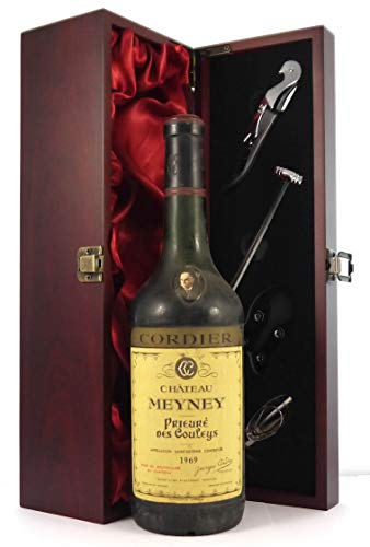 Photo of Chateau Meyney Prieure Des Couleys 1969 St Estephe Cru Bourgeois vintage wine in a silk lined wooden box with four wine accessories, 1 x 750ml