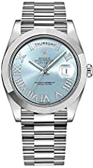 Roman Numeral Ice Blue Dial Diamonds Set on Roman Numerals Platinum Case & President Bracelet Case Diameter: 41mm Self Winding Automatic Chronometer Movement, Day and Date Features