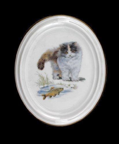 Médaillon en porcelaine motif chat et de poisson
