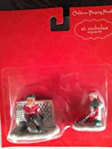St. Nicholas Square Set of 2 Children Playing Hockey Christmas Village Figurines