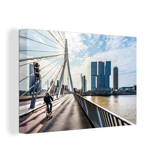 Leinwandbild - Rotterdam, Niederlande - 7. Juni 2016 : erasmusbrücke in rotterdam, radfahrer fährt in den sonnenaufgang, rotterdam, niederlande - 30x20 cm