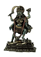7.25 inch High, 5.5 inch Long, 2 inch Wide Made of Cold Cast Bronze, a Process of Mixing Bronze Powder with Resin, Giving the Piece a Lustrous Metallic Bronze Finish Depicts Kali Stepping On Lord Shiva's Chest In Order to Calm Her Wild Frenzy Kali is...