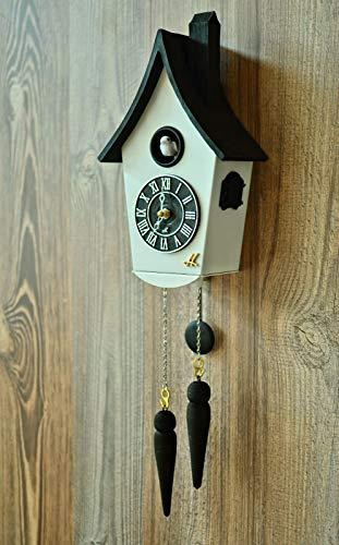 CLOCKVILLA Moderne Kuckucksuhr weiß schwarz mit Lautstärkeregelung Quarz batteriebetrieben