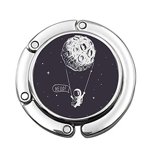 Astronaut reitet eine Schaukel, die an den Mond gebunden ist Faltbare Lady Handtasche Tisch Schreibtisch Kleiderbügel Haken Geldbörse Tisch