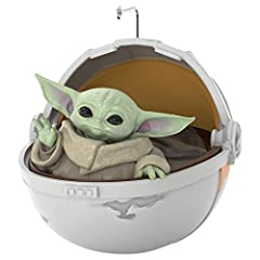 """Add some precious cargo to your tree with the Child from """"The Mandalorian."""" This Keepsake Christmas ornament features the beloved new character—often referred to as """"Baby Yoda"""" by fans—in his hovering pram. Artist crafted by Jake Angell, this Keepsak..."""