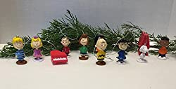 Image: Peanuts Movie Classic Figure Set of 12 Christmas Ornaments with Snoopy, Woodstock, Dog House, Lucy, Linus Etc