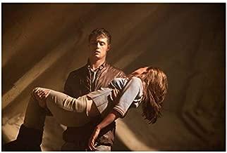 Jake Abel as Ian O'Shea Holding Saoirse Ronan as Melanie Stryder in The Host 8 x 10 Inch Photo