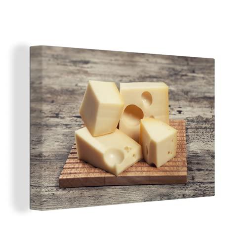 Canvas Schilderijen - Een plankje met blokjes kaas - 150x100 cm - Wanddecoratie - canvas met 2cm dik frame