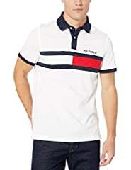 A classic in every sense of the word. This Tommy Hilfiger polo shirt is a casual wardrobe must-have. Polo shirt for men available in a custom fit. Polo shirt collar with a two-button placket. Embroidered flag at chest on this polo shirt for men. This...
