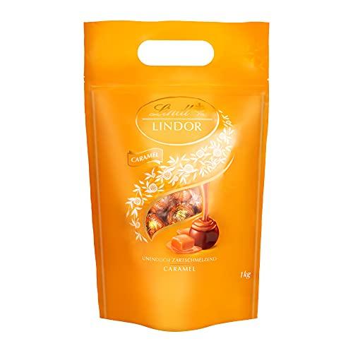 Lindt LINDOR Beutel Caramel, gefüllt mit LINDOR Kugeln aus feiner Milchschokolade und einer unendlich zartschmelzenden Karamellfüllung, 1er Pack (1 x 1kg)