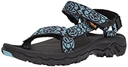A pair of black and blue Teva Hurricane sandals.