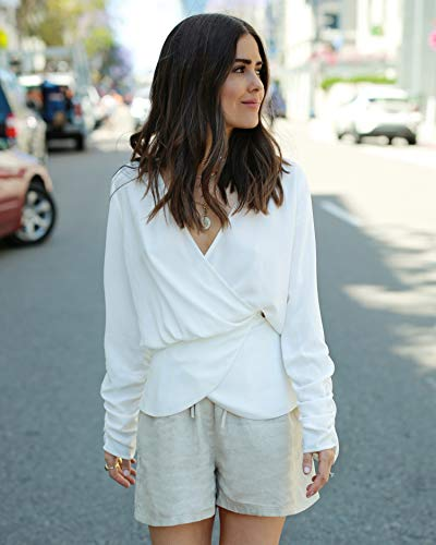 The Drop Women's Ivory V-Neck Peplum Blouse by @paolaalberdi