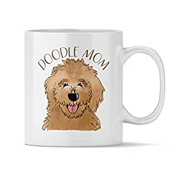 A coffee mug with a Goldendoodle's face and words Doodle Mom makes a fun Goldendoodle gift, photo