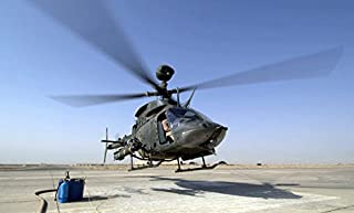 An OH-58D Kiowa Warrior helicopter taking off from Forward Operating Base MacKenzie in Iraq Poster Print by Stocktrek Images (17 x 11)