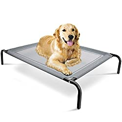 Golden Retriever laying on a grey elevated dog bed.