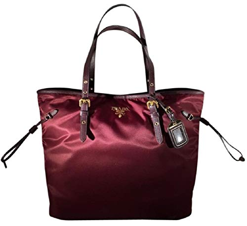 Granato Burgundy nylon with leather trim Gold Tone Hardware with Double Zipper Closure 1 interior zip pocket and open pocket, adjustable leather straps 15 x 5 x 12 inches Includes authenticity cards and Prada dust bag. Made in Italy