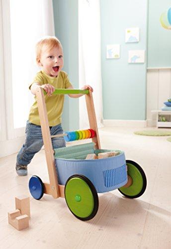 HABA 6432 – Lauflernwagen Farbenspaß, Lauflernhilfe aus Holz und Textil mit bunten Spielelementen, Transportfach für Spielsachen, Bremse und Gummirädern, ab 10 Monaten - 4