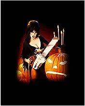 Elvira 8x10 Inch Photo Elvira: Mistress of the Dark w/Chainsaw & Pumpkin Candles in Background Pose 2 kn