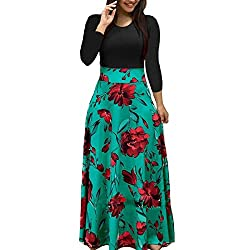 Two tone floral dress with teal full skirt and red flowers.