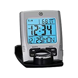 A foldable digital travel alarm clock displaying the time and date.