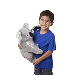 """Sitting stuffed plush lifelike koala bear Realistic details include big shaggy ears, deep brown eyes, a squishy nose, pink tongue, and sweet expression Padded hands and feet include fingers and toes with soft, sewn-in """"claws"""" Silky-soft gray and whit..."""