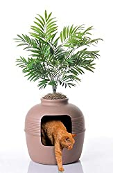 A litter box for cats concealed inside a potted plant