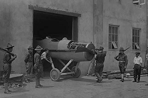 At college point aircraft manufacturing plant in Queens New York a Fighter sans wings is moved out the plant door for finally assembly and shipment to Europe to fight in the Great War Poster Print by -  Buy EnLarge, BLL058745805L