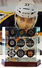 Patrice Bergeron Boston Bruins Signed Autographed Nine Puck Collection with Case