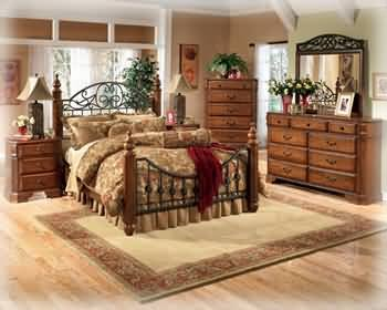 Big Sale Ashley Wyatt Iron Poster King Size Bedroom Set in Rich Oak Finish