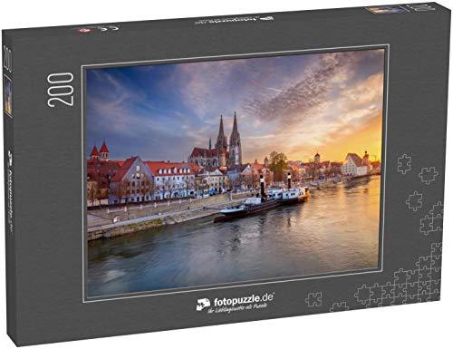 fotopuzzle.de Puzzle 200 Teile Regensburg. Stadtbild von Regensburg, Deutschland bei Sonnenuntergang im Frühjahr