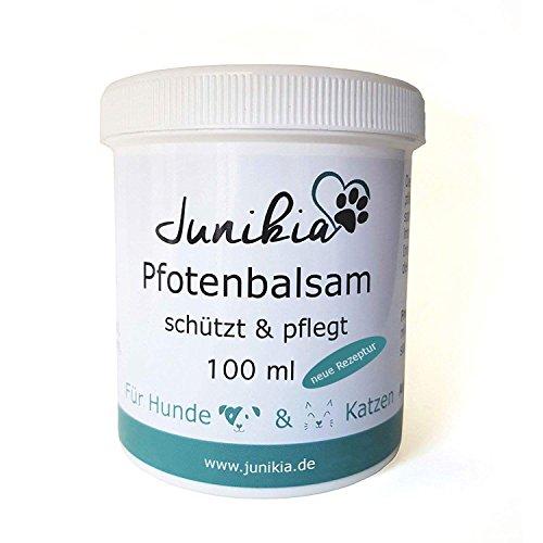 Junikia Pfotenbalsam für Hunde und Katzen pflegt trockene und rissige Pfoten und schützt mit Arnikaöl, Zink und Propolis (100 ml)