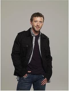 Bones (TV Series 2005 - ) 8 Inch x10 Inch Photo T. J. Thyne Black Jacket Over Blue Button Down and Navy Tee & Jeans Grey Background kn