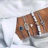 Les bracelets multicouches sont disponibles dans une variété d'éléments glamour. Tels que les perles turquoises, les tortues, les cartes du monde, les objets décoratifs en forme de cœur, etc. Les bracelets empilés sont fabriqués avec des matériaux pl...