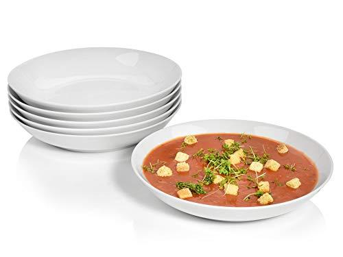 Edler Curry-Zitronengras-Cappuccino mit Jacobsmuschel-Spieß