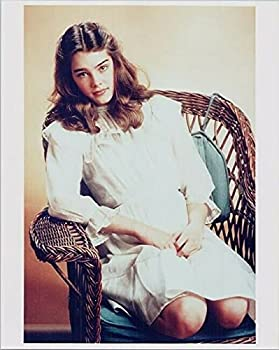 Brooke Shields young pose in white dress seated on chair 24x36 Poster