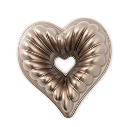 Heart Shaped Baking Essentials for Valentines Day featured by top US dessert blog, Practically Homemade: heart shaped bundt cake pan