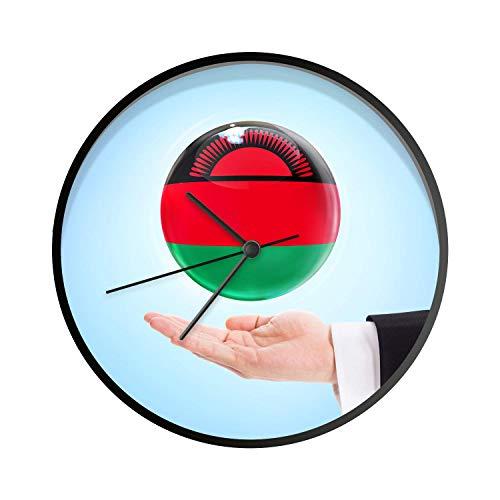 Uhr - Ø 30 cm - Schwarz - Die Flagge von Malawi schwebt über Einer Hand - Wanduhr