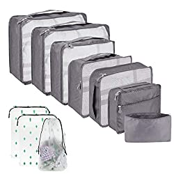 A variety of sizes of packing cubes lined up together