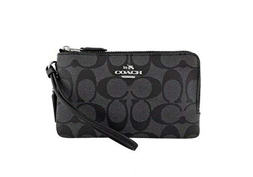 """Imported - Signature Coated Canvas Double Zip Closure - Silver Tone Hardware Interior Features: Black Fabric Lining - Back Pocket has 2 Slip Pockets Attached Wrist Strap Approximate Measurements: 6 1/2' (L) x 3 3/4"""" (H)"""
