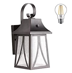 One-light exterior wall lantern with dusk-to-dawn. **Must be wired with 120V AC/DC power supply. Not battery, neither solar power photocell. Oil rubbed bronze finish on steel; seeded glass panels(Tip*Productive process can't ensure the consistency of...