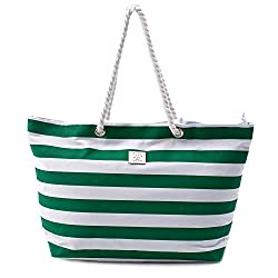 A large green and white canvas beach bag with rope handles
