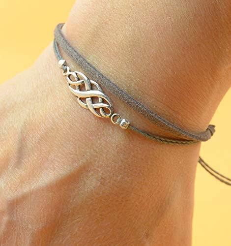 Sterling Silver Celtic Knot charm bracelet. Mens or women bracelet