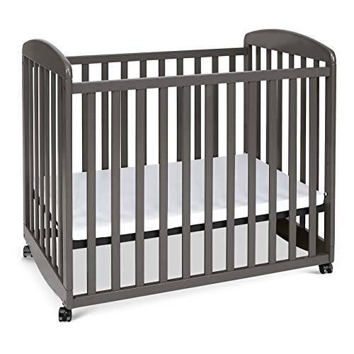 Davinci Alpha Mini Rocking Crib in Slate, Removable Wheels, Greenguard Gold...