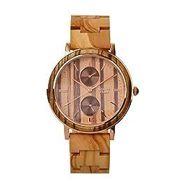 Materiale cinturino: 100% legno: legno zebrano Colore del quadrante: marrone. Meccanismo: al quarzo. Materiale della cassa: acciaio inox. Funzioni: visualizzazione 24 ore, visualizzazione del giorno.