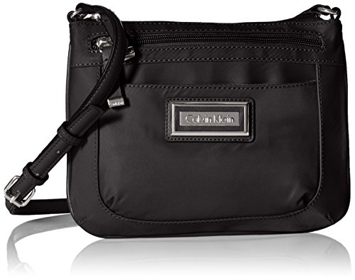 Nylon bag with metallic logo plate featuring adjustable cross-body strap