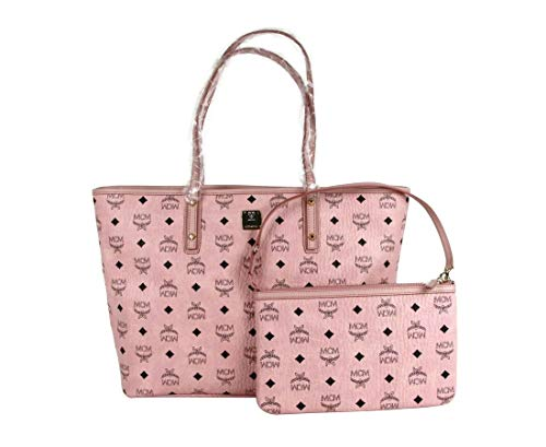 Made of coated canvas / leather; Zip top closure; Dual flat handles Removable wristlet pouch; Gold tone hardware Style: Tote; Closure: Zip Measurements: Bag Height: 9.8; Bag Depth: 5.1; Bag Width: 12.9 Inches Original MCM tags, dust bag and authentic...