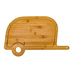 A cutting board shaped like a vintage tow-behind camper.