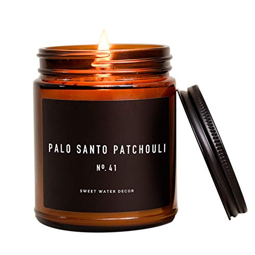 Sweet Water Decor Palo Santo Patchouli Candle   Black Pepper, Clove, Lavender, Cedarwood Scented Soy Candles for Home   Gifts for Women, Men, Housewarming   9oz Amber Glass Jar, 40 Hour Burn Time