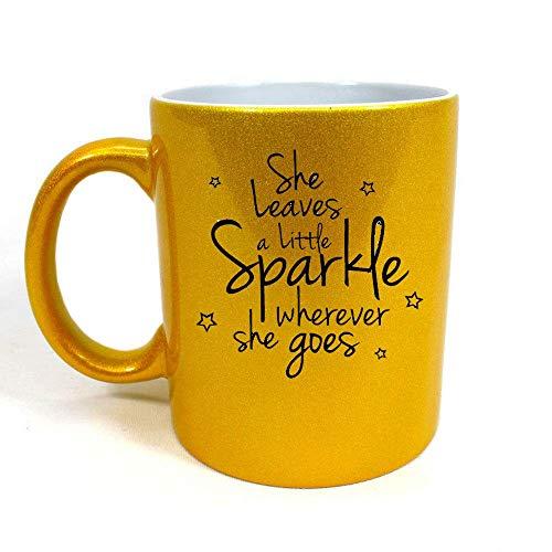 LBS4ALL - Taza de oro (325 ml, con texto en inglés), diseño con texto en inglés 'She Leaves a Little Sparkle Wherever she Goe', color dorado