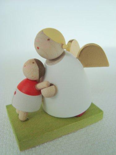 Günter Reichel Schutzengel mit Püppchen mit kleiner Puppe, handgefertigt, Kunsthandwerk aus dem Erzgebirge, Schutzengel für Kinder, für kleine Puppenmuttis, für kleine und grosse Mädchen